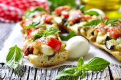 Pizza with eggplants on a french baguette. Stock Photo