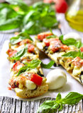 Pizza with eggplants on a french baguette. Stock Photography
