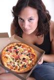 Pizza el oler de la muchacha Foto de archivo
