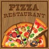 Pizza em um fundo de madeira Imagens de Stock Royalty Free