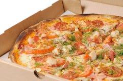 Pizza em uma caixa Fotos de Stock