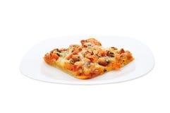 Pizza em uma placa Foto de Stock