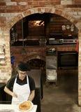 Pizza en el fuego Imagen de archivo libre de regalías