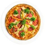 Pizza en el plato blanco Imagen de archivo libre de regalías