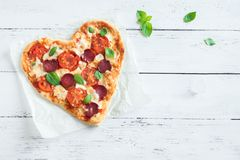 Pizza en forme de coeur Photographie stock