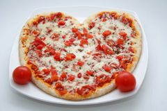 Pizza en forme de coeur Photo stock