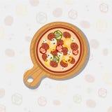 Pizza en tarjeta de madera Foto de archivo libre de regalías