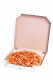 Pizza enfermée dans une boîte Photographie stock libre de droits