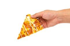 pizza för manhandhåll arkivfoto
