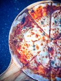 Pizza on a wooden tray stock images