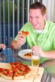 Pizza felice Fotografie Stock