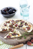 Pizza with figs and cheese. Fig and goats cheese pizza with thyme and pistachios. Country style setting stock photography