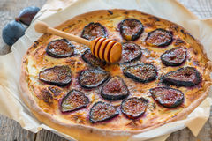 Pizza with figs, honey and thyme. Stock Image