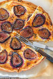Pizza with figs and thyme. Top view. Royalty Free Stock Image