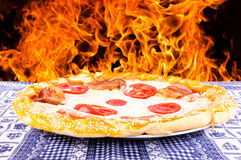 Pizza fire Royalty Free Stock Photo