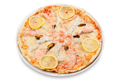 Pizza with  fish and seafood. Pizza with fish and seafood on white plate Royalty Free Stock Images