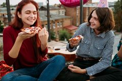 Pizza food delivery party teenage eating lifestyle. Italian pizza delivery. Youth eating preferences. Party with tasty and delicious food. Teenage lifestyle Stock Image