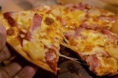 Pizza food on wood blurred stock images