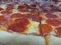 Pizza foodcloseup Lizenzfreie Stockbilder