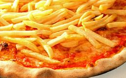 Pizza with French fries Stock Photos