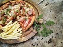 Pizza and frenfried Stock Photo