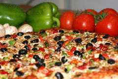 Pizza and fresh ingredients Royalty Free Stock Image