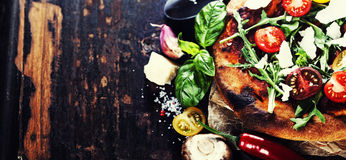 Pizza and fresh italian ingredients Stock Photo
