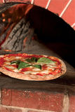 A Pizza Fresh Out of a Wood-fired Brick Oven Stock Images