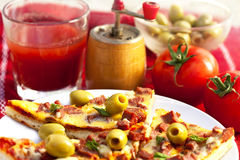 Pizza and fresh tomato juice Royalty Free Stock Photography