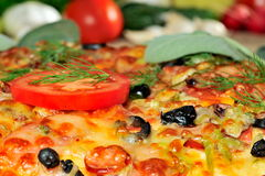 Pizza and fresh vegetables Stock Photo