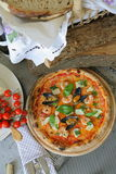 Pizza `Frutti di mare` with mussels, clams and fresh basil Stock Photos