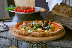 Pizza `Frutti di mare` with mussels, clams and fresh basil Royalty Free Stock Photo