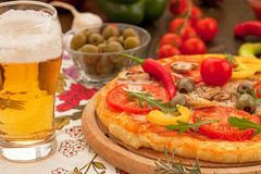 Pizza with glass of beer Stock Photography