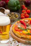 Pizza with glass of beer Royalty Free Stock Photo