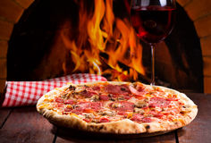 Pizza and glass of wine Royalty Free Stock Images
