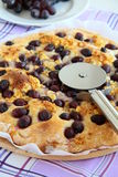 Pizza with grapes and cheese. And pizza with a pizza knife Stock Photography