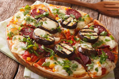 Pizza with grilled eggplant, sausage, corn and cheese close-up. Stock Photography