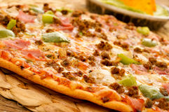 Pizza with ground beef, ham, onion and green pepper Royalty Free Stock Photography