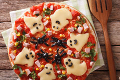 Pizza Halloween with ghosts cheese and olives spiders close-up. Royalty Free Stock Photos