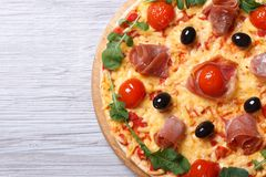 Pizza with ham and arugula closeup horizontal top view Royalty Free Stock Photo
