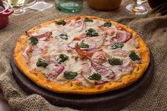 Pizza with ham cheese and spinach Stock Photos