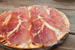 Pizza with ham and cheese. Stock Photos
