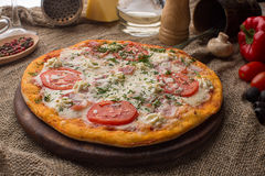 Pizza with ham cheese and tomatoes Royalty Free Stock Photos