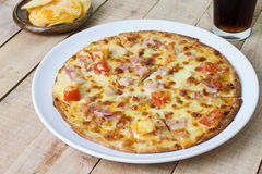 Pizza with ham and cheese on wood background Royalty Free Stock Photo