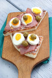 Pizza with ham, egg. And some olive Royalty Free Stock Photography