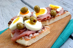 Pizza with ham, egg and some olive. Pizza with ham, egg and some green olive Royalty Free Stock Photo