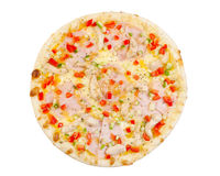 Pizza with ham, fish, cheese, paprika and cucumber, isolated Stock Images