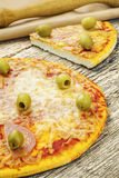 Pizza with ham and green olives Stock Photography
