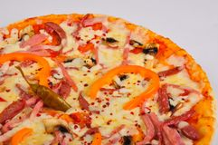 Pizza with ham and jalapeno pepper stock photography