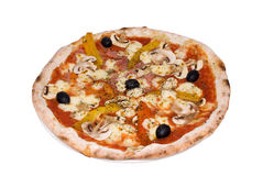 Pizza with ham, mozzarella, peppers, mushrooms Royalty Free Stock Image